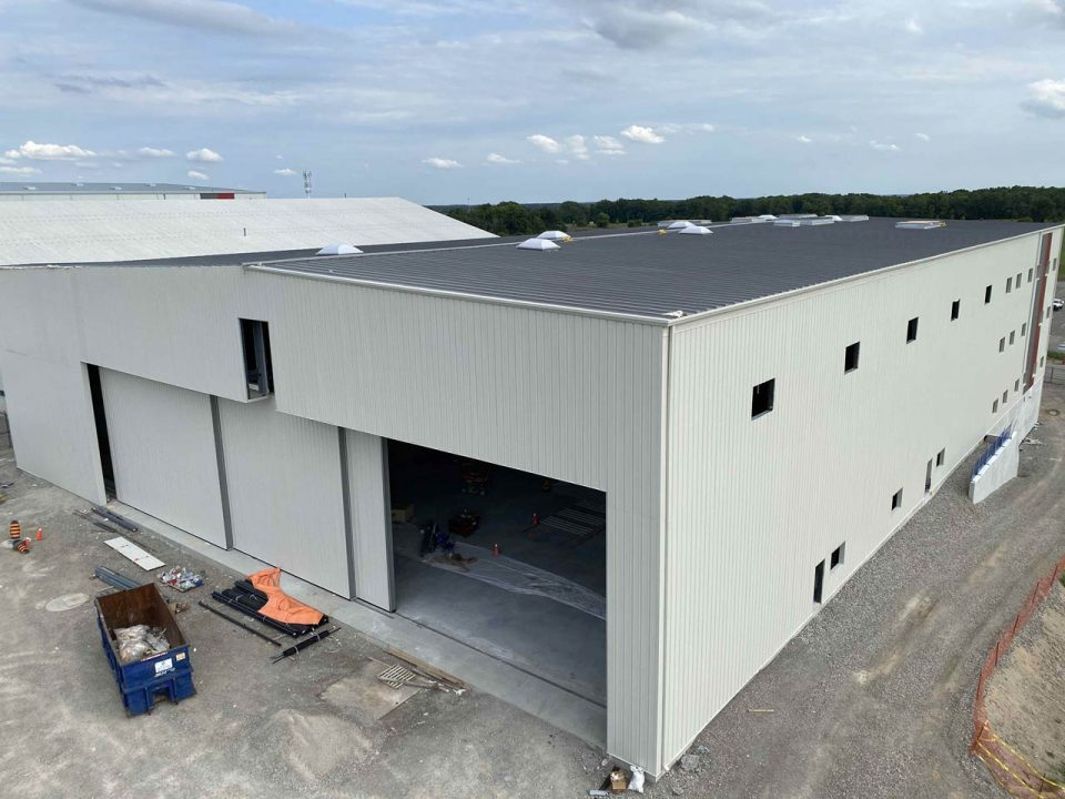 Mohawk Aviation Project by BBGunn pre-engineered metal building erecting, installation of wall cladding systems, steel roofs and insulated metal panel, structural steel, welding, and steel decking.